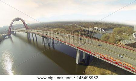 Suspension bridge over the Moscow River - Zhivopisny bridge, Moscow, Russia, aerial view