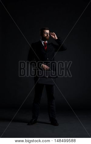 Businessman  over black background. Business and office concept.