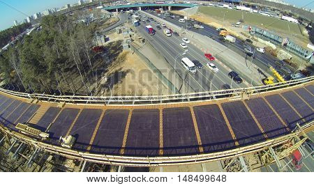 Construction of an overpass on the highway on a sunny spring day, aerial view