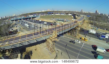 Car traffic on the highway with road junction under construction, aerial view
