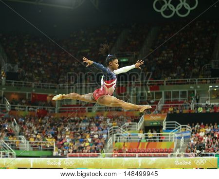 RIO DE JANEIRO, BRAZIL - AUGUST 9, 2016:Olympic champion Simone Biles of United States competes on the balance beam at women's team all-around gymnastics at Rio 2016 Olympic Games at Rio Olympic Arena