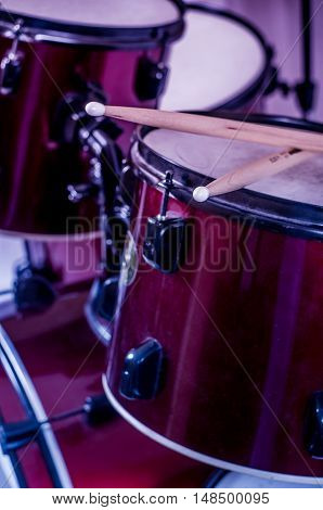 Drums conceptual image. Picture of drums and drumsticks lying on snare drum