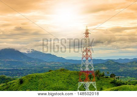 telecommunication tower during sunset mountain background in rainy season