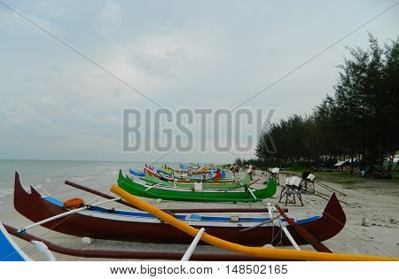 These boats belong to the fishermen at Belitung Island, Indonesia. They usually go fishing about 6-7PM and back home at noon.nStruggling but energetic people.