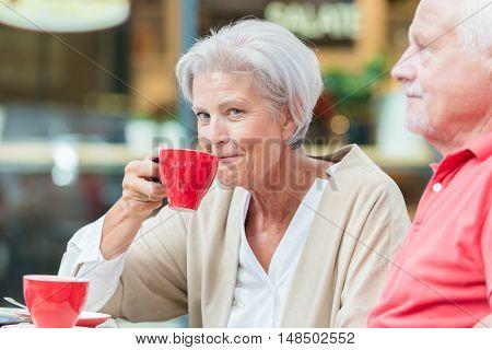 Seniors drink a coffee