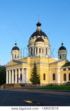 RYBINSK RUSSIA - JULY 21 2016: Unidentified people walk down street near Saviour Transfiguration Cathedral Rybinsk Russia