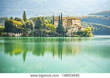 An image of the beautiful Castel Toblino in Italy in the morning light