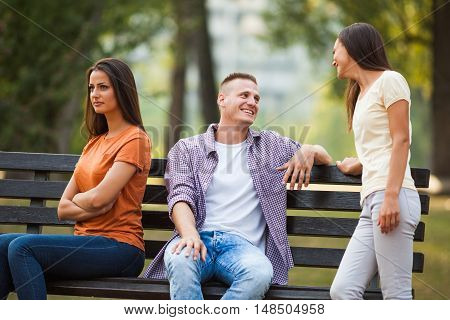 Man is talking to other woman and his girlfriend is offended.