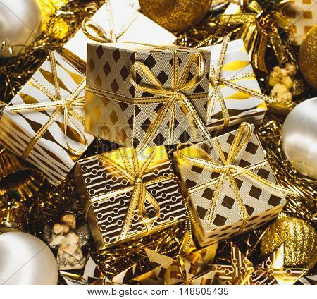 Decorated Golden Christmas Gifts Box Presents with Gold and White Ribbon, Many Christmas Presents Boxes With Twine And Decorations On A Table, Xmas boxes With Bows, Christmas Card Poster Banner.