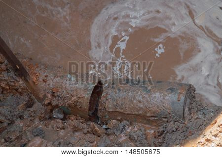 selective focus pipe plumbing broken in hole with water motion the pipe severe