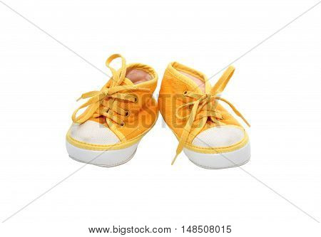 Nice yellow baby shoes on white background. Isolated with clipping path