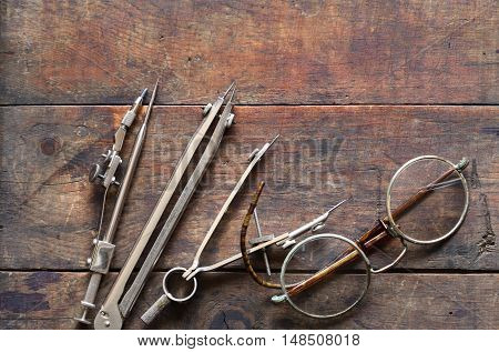 Set of vintage drawing instrument on old wooden background