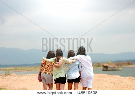 soft focus with Happy woman friends having fun and expressing emotions look at the moutain