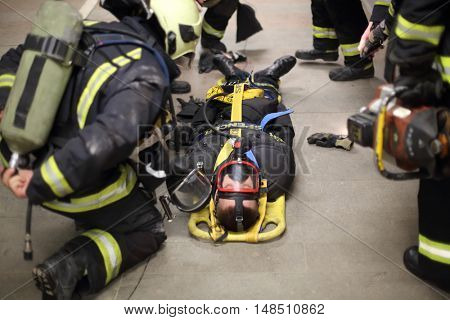 RUSSIA, MOSCOW - FEB, 26 2015: Firefighters in uniform are training to help suffer at Preobrazhenskaya ploshchad subway, focus on belt.