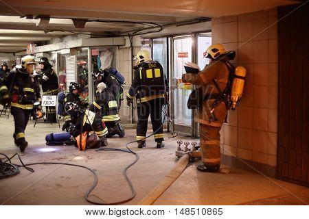 RUSSIA, MOSCOW - FEB 26, 2015: Firefighters in uniform are training at Preobrazhenskaya ploshchad subway.