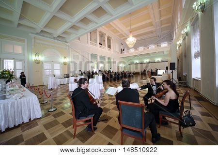RUSSIA, MOSCOW - 05 MAR, 2015: Group of violinists are performing at literary award Yasnaya polyana in the Pashkov house.