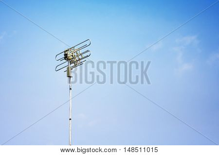single Telecoms mast in a rural blue sky landscape