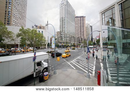 NEW YORK - August 23, 2014: People and cars on Broadway