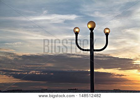 Lamppost and sunset sky, lantern at sunset, light pole with sunset
