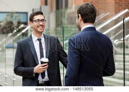 Two businessmen talking outdoors