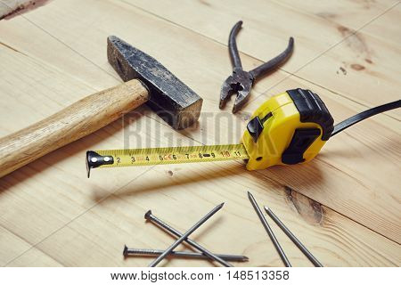 set of tools over wood background