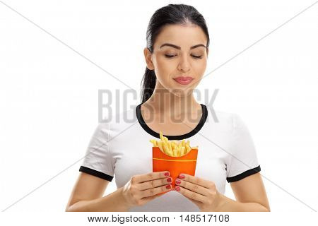 Woman looking at a bag of fries isolated on white background