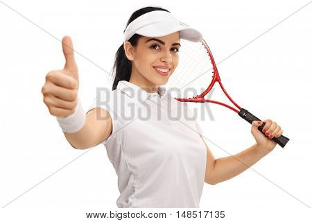 Female tennis player giving a thumb up and holding a racket isolated on white background