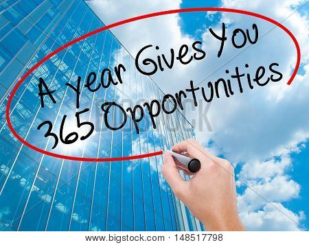 Man Hand Writing A Year Gives You 365 Opportunities With Black Marker On Visual Screen