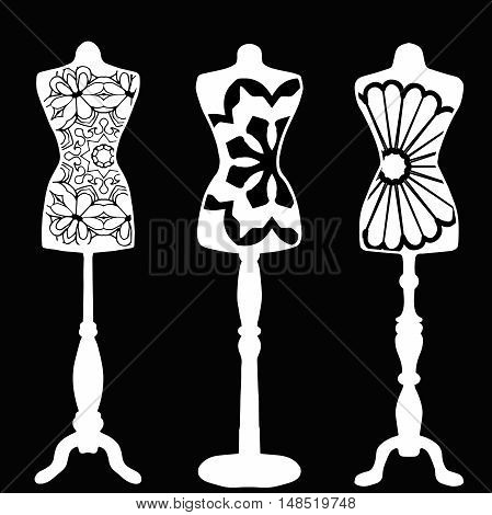 Mannequins drawn in outline on black background with cool pattern