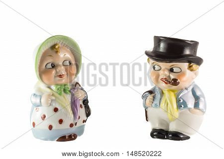 Porcelain figures of grandparents in retro style on white background