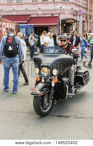 St. Petersburg, Russia - 12 August, Biker rides between people,12 August, 2016. The annual International Festival of Motor Harley Davidson in St. Petersburg Ostrovsky Square.
