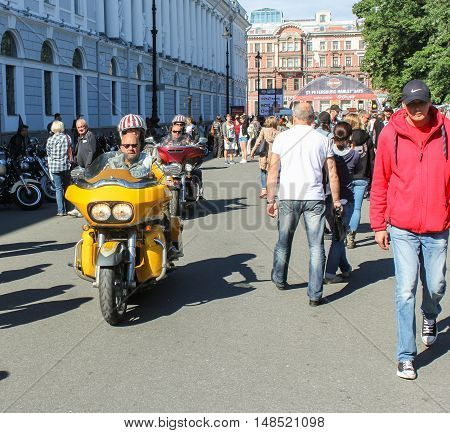 St. Petersburg, Russia - 12 August, Arriving couple of bikers,12 August, 2016. The annual International Festival of Motor Harley Davidson in St. Petersburg Ostrovsky Square.