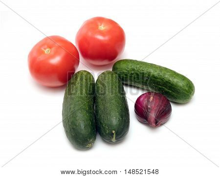 Fresh vegetables isolated on white. Cucumbers, tomatoes and onion top view closeup