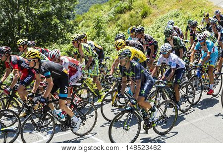 Col D'AspinFrance- July 152015: Froome of Team sky in Yellow Jersey and his main rivals Quintana of Movistar Team in White Jersey and Nibali of Astana Team climbinginside the peloton the road to Col D'Aspin in Pyrenees Mountains during the stage 11 of Le