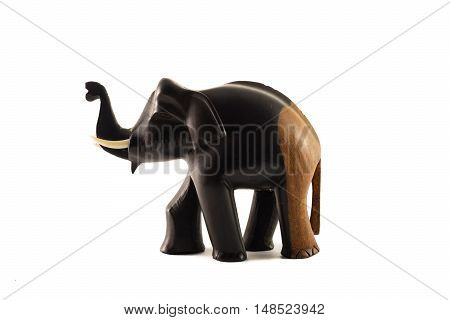 The wooden statue of the elephant black and brown on a white background