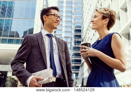 Two colleagues walking together in a city