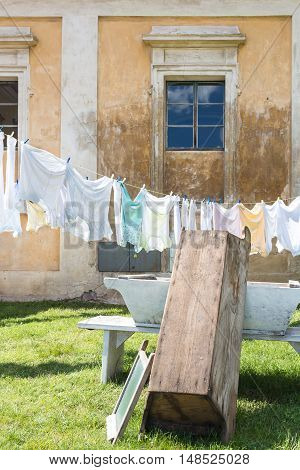 Decoration in the garden of manor-house Milotice in Czech republic. Traditional way of cleaning the laundry and drying it on the fresh air in the sunshine.