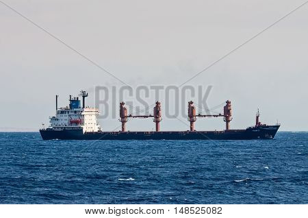 Sharm El Sheikh Egypt - November 24 2010: General cargo ship Tykoon II sails along the shore of the Red Sea near Sharm El Sheikh Egypt at November 24 2010. Type of vessel: General cargo. Flag: Panama.
