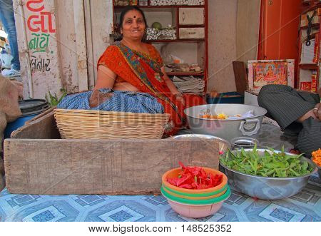 Woman Is Selling Herbs Outdoor In Ahmedabad, India