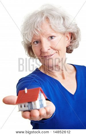 Eldery Woman With Small House