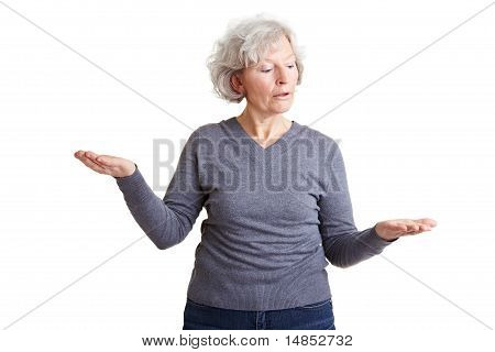 Elderly Woman Comparing Two Imaginary Objects