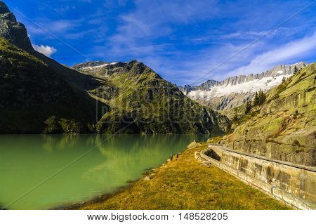 Idyllic Summer Landscape With Clear Mountain Lake In The Alps