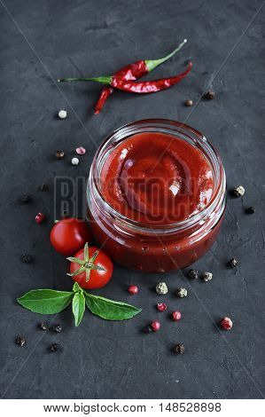 Tomato Sauce And Basil In Glass Jars