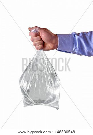 Hand holding transparent plastic water bag on white background.