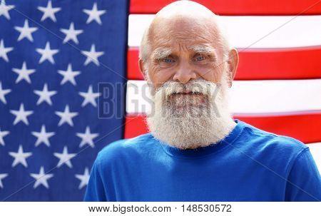 Elderly man on American flag background