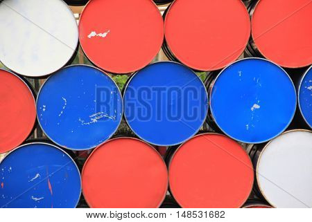 Large metal barrels stacked in a row