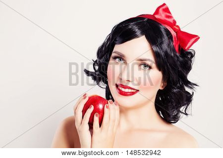 Cute Woman with Red Apple Fruit on gray