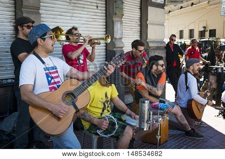 Buenos Aires Argentina - October 6 2013: Street musicians playing in a street in the San Telmo neighborhood in the city of Buenos Aires in Argentina