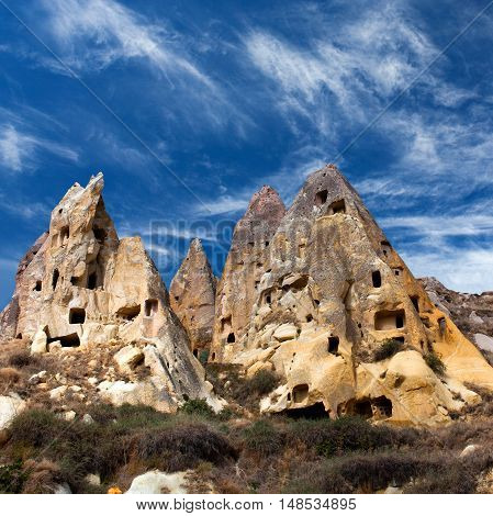 Unique geological formations in Cappadocia, Central Anatolia, Turkey. Cappadocian Region with its valley canyon hills located between the volcanic mountains Erciyes, Melendiz and Hasan.
