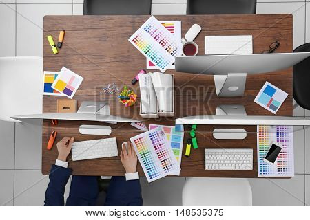 Businessman in office, top view